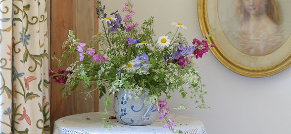 A vase of freshly picked flowers decorates the cottage