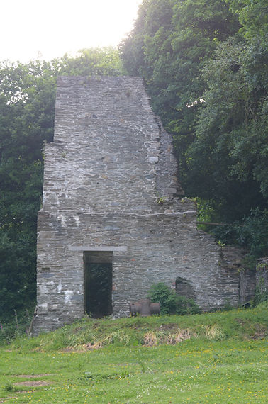 South Hooe Mine engine house stands in the garden of the Count House