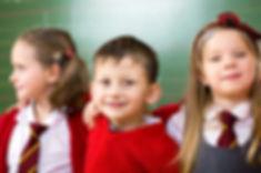 Smiling primary kids x 3.jpg