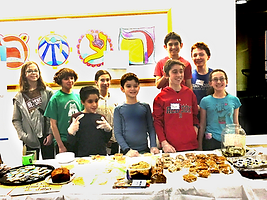 Students at Kesher Newton hosting a bake