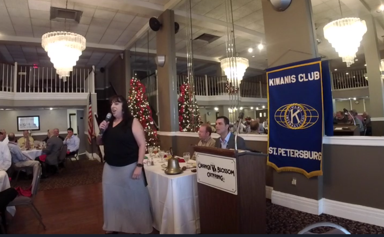 Traci speaking at Kiwanis Club