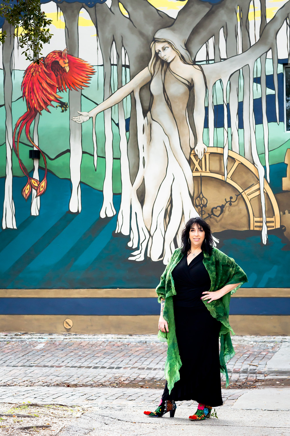 Traci Kanaan in front of a mural in St Petersburg, FL
