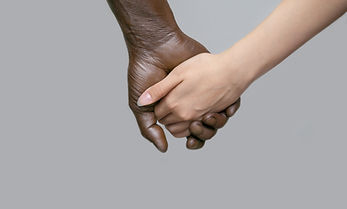 A black male hand holds a white female h