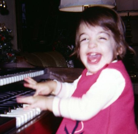 Traci Kanaan playing the organ at the age of 2