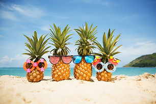 Family of funny attractive pineapples in