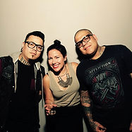 Katia with firm clients, internationally renowned tattoo artists Darwin Enriquez and Yomico Moreno.
