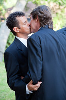 Handsome gay wedding couple, kissing at