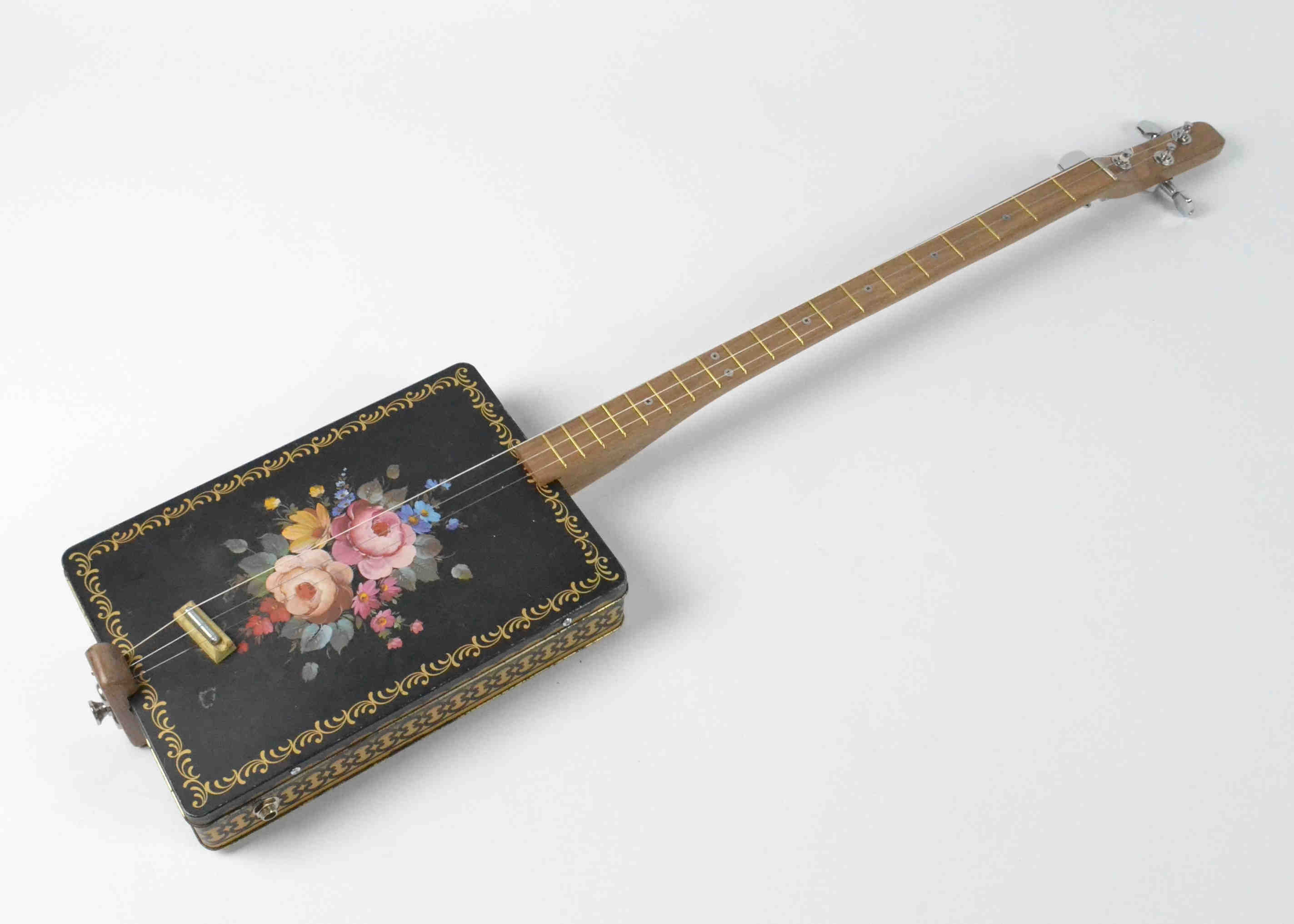 Floral Design Tin Guitar