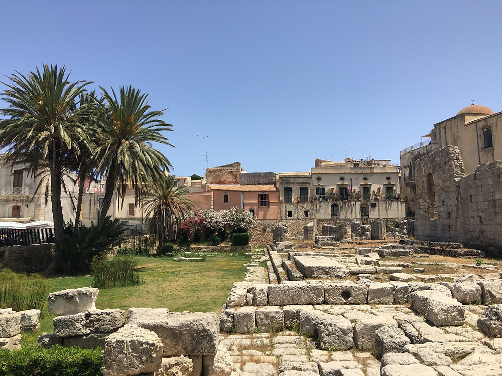 I believe that this is the remains of the Temple of Apollo in Ortigia, Sicily.