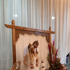 Wedding arch with boho panel & beaded cotton curtain