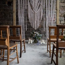 Wedding arch with macrame hanging