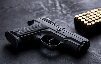 gun-ammunition-on-dark-background-260nw-