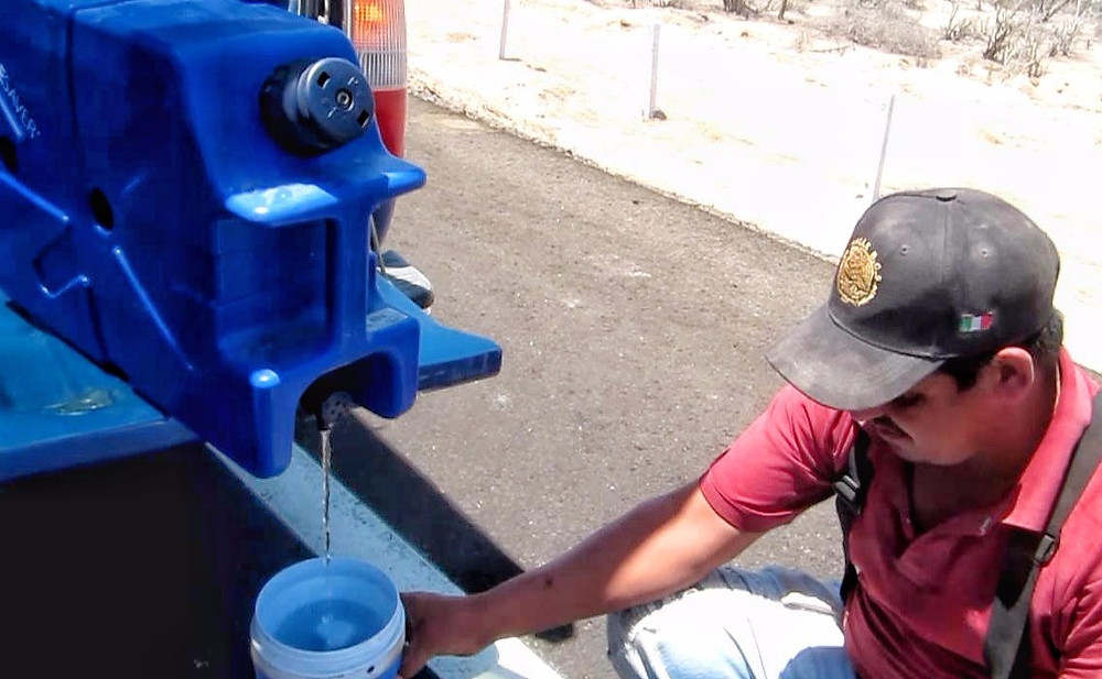 filtering water for some construction workers in mexico