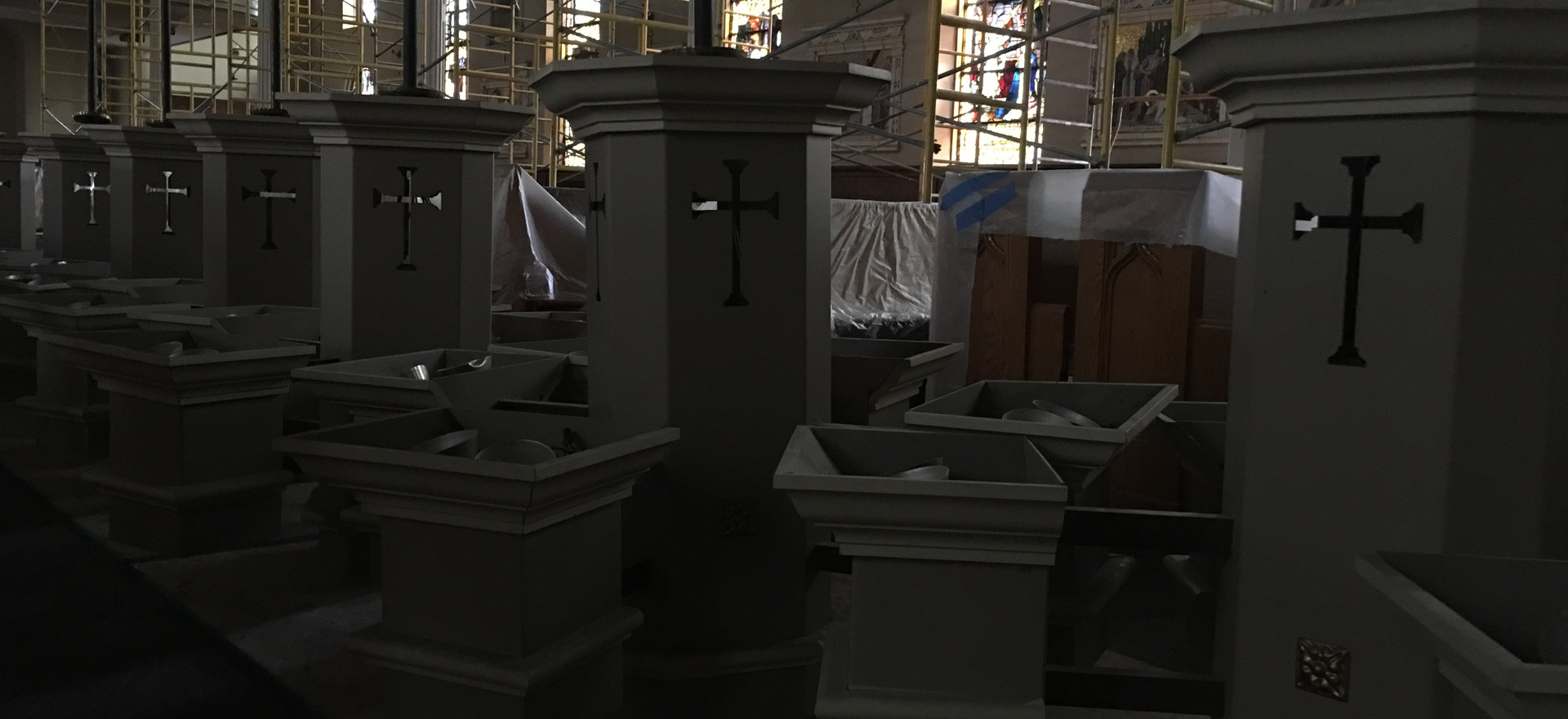 The pendant lights awaiting removal from the church.