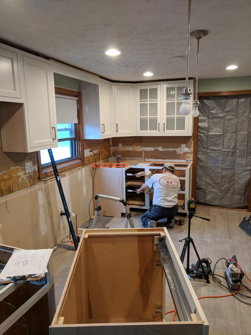 working on base cabinets