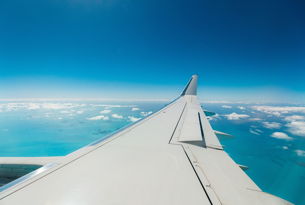 An Airplane Wing in a Blue Sky, Travel