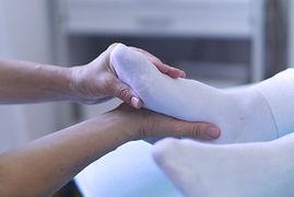 Shiatsu-Behandlung am Fuss
