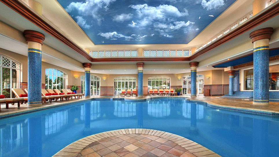 impressive indoor pool surrounded with loungers