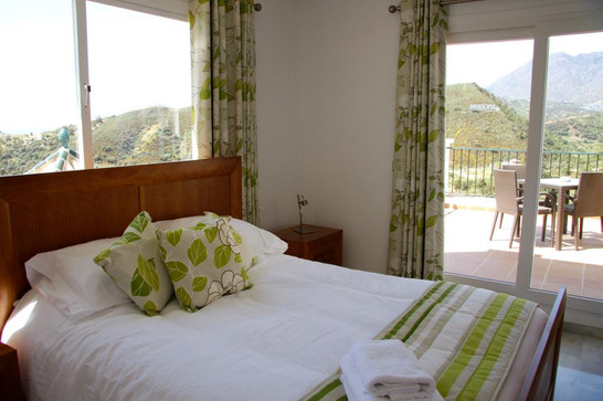 Dual aspect double bedroom with mountain views