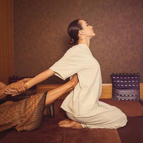 On-floor and seated Thai massage