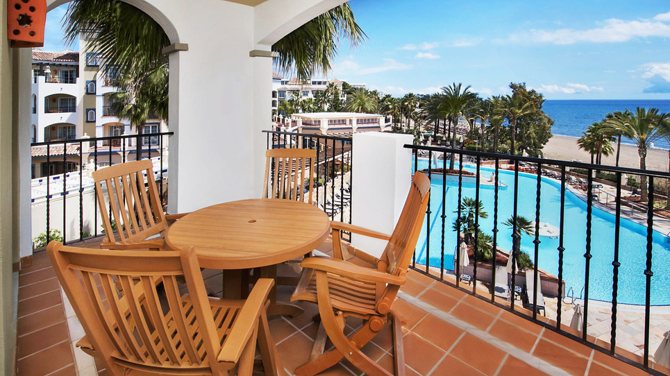 Balcony with outdoor furnitur and pool view