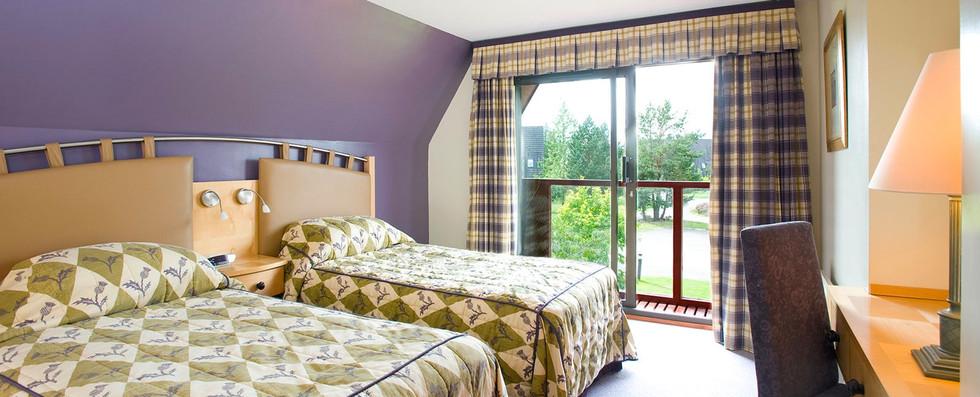 Coylumbridge Lodge bright bedroom