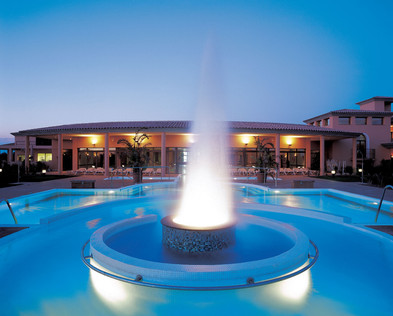 Pool with fountain at dusk