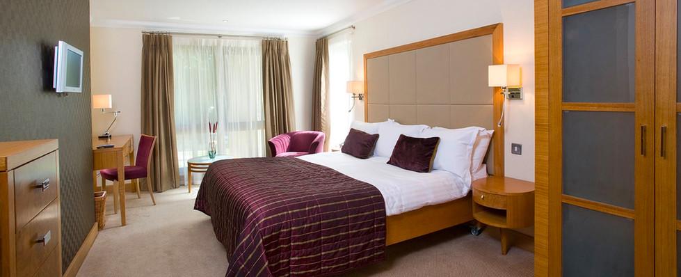 Stylish bedroom at Dunkeld Lodges