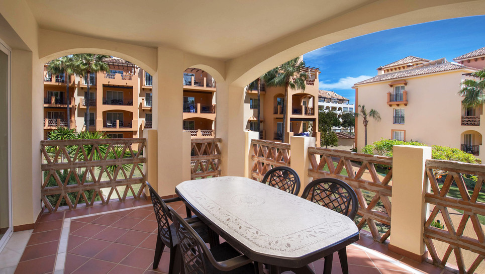 Large balcony with outdoor furniture
