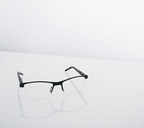 pair of black half framed eyeglasses_edited.jpg