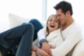 couple_laughing_on_sofa.jpg