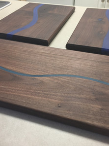 Walnut cutting boards with colored epoxy