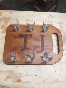 Cherry shot board with walnut inlay