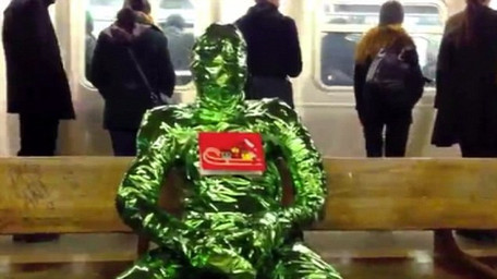 person wrapped in green foil