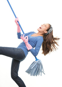 woman with air guitar broom