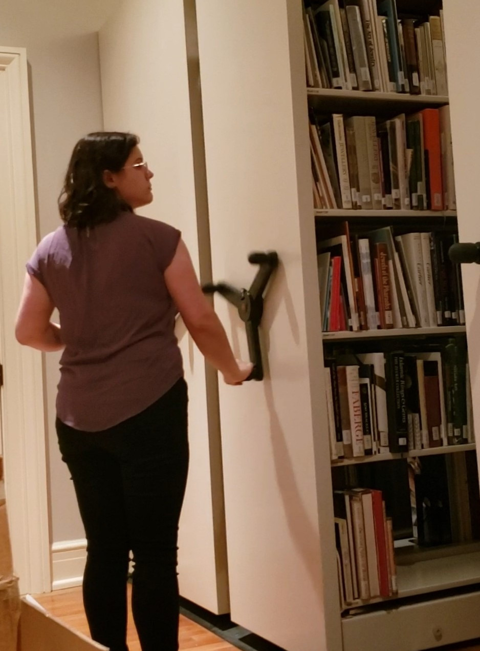 Lindsey researching in the Book Room at the Museum with the non-circulating research Library Collection.