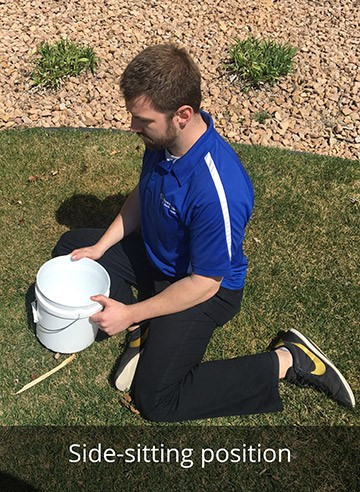man demonstrating how to side sit in yard when doing yardwork