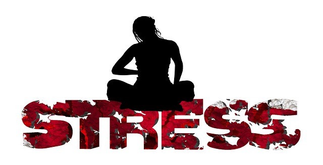 The word stress in red with silhouette of woman sitting on letters
