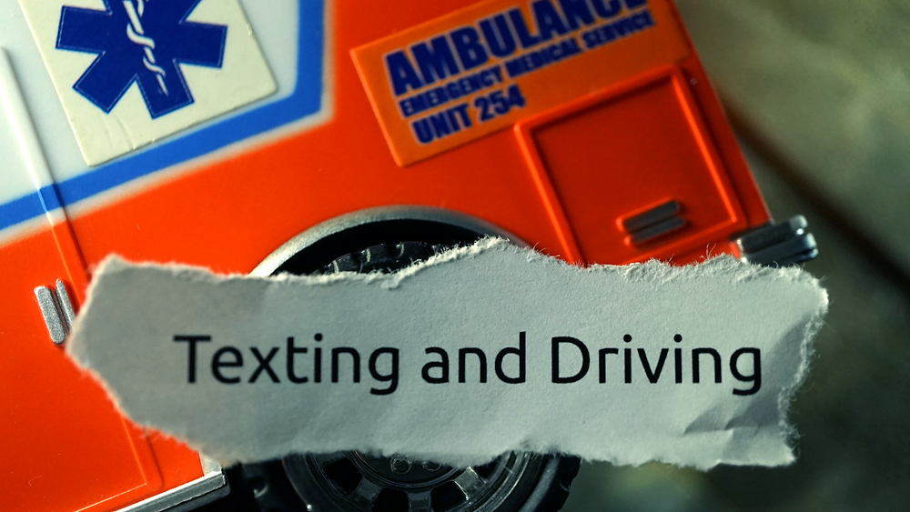 Texting and Driving with Ambulance in background