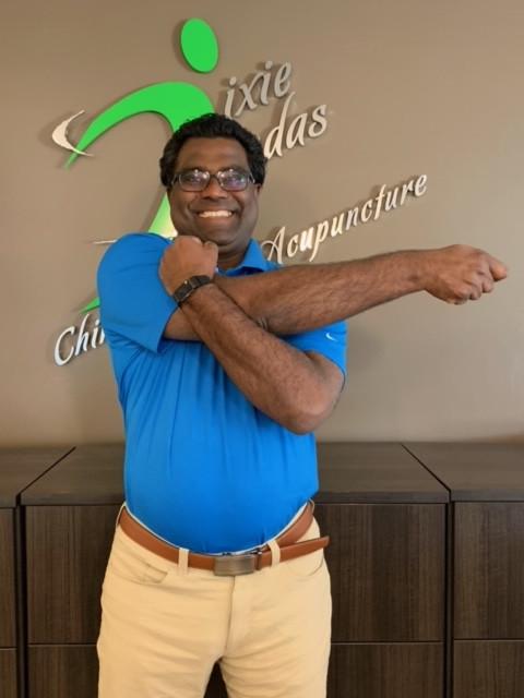 Dr. Andre demonstrating bent arm upper back and shoulder stretch