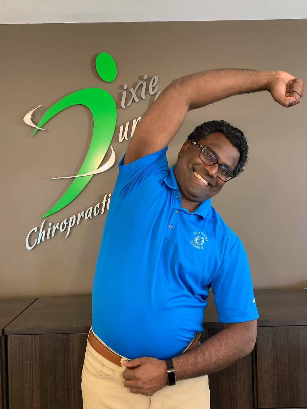 Dr. Andre demonstrating lateral side stretch for golf