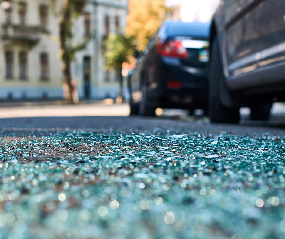 auto collision with broken glass on ground