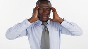 African american man holding his head - headache