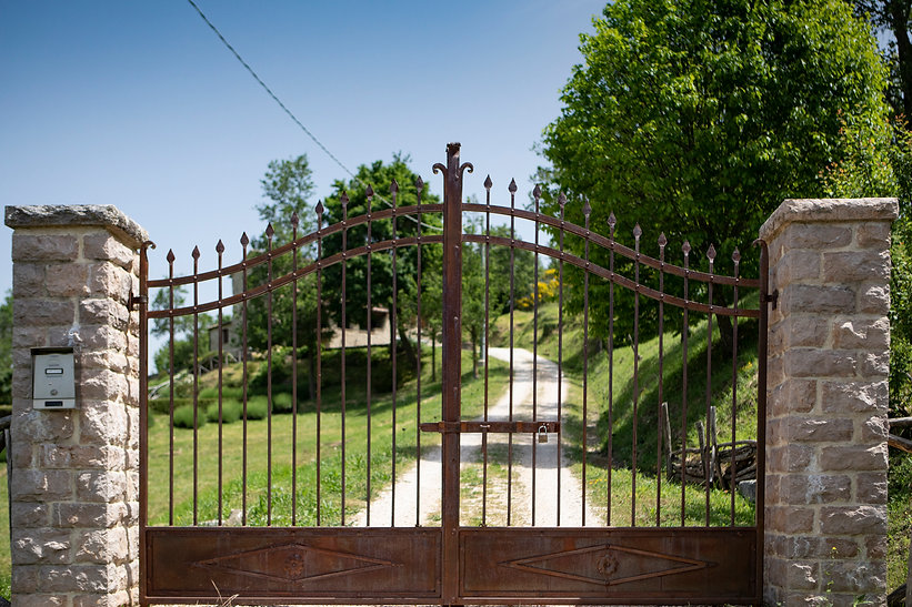 wrought iron hand made gates stone pillars private drive