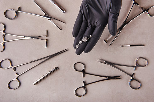 piercer master's hand in a medical black
