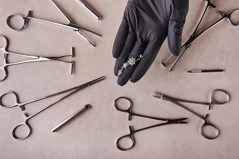 piercer master's hand in a medical black