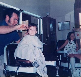 Dennis Miller & Sam (Sharon) at the original barber shop in 1968 .jpeg