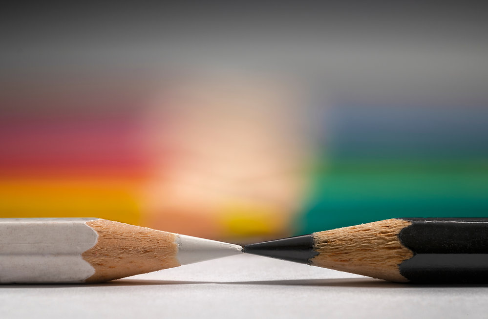 black and white pencils with colored pen