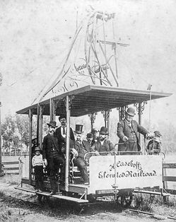 1 - 1887 - overhead experimental cable car in blair park  with inventor Henry Casebolt at