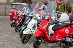 row-of-classic-vespa-scooter-parked-in-t